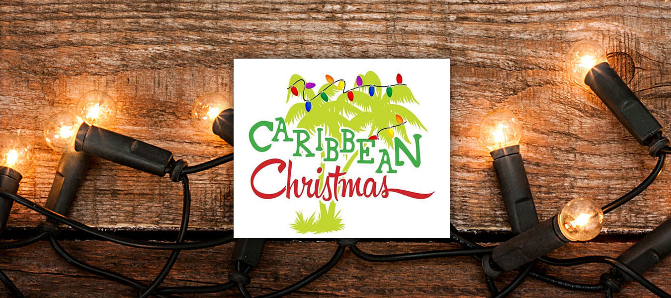 Caribbean Christmas Banner with Logo and Christmas lights on a wooden wall.
