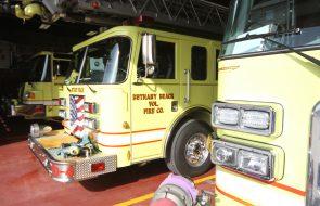 Three firetrucks sitting in a fire station