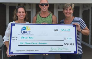 A giant check from QRCF to Brooke Beam