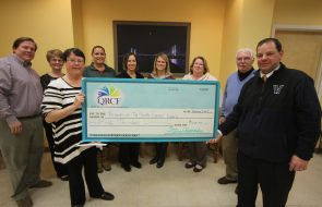A check worth $5000.00 for Friends of the South Coastal Library