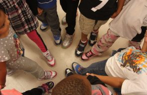 Kids putting their shoes into a circle to show them off