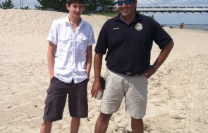 A scout and man out at the beach