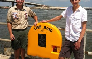 Two eagle scouts in front of the ocean