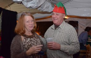 A woman and man wearing an elf hat