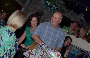 A man with wrapping paper and presents